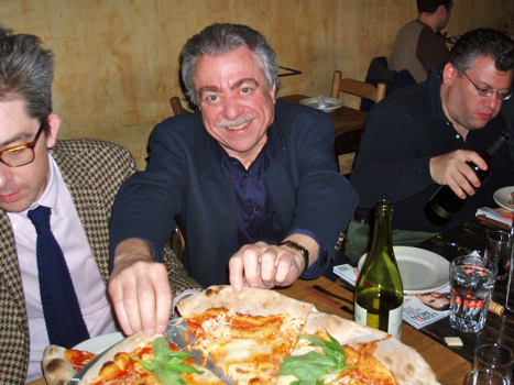Alan tears into Lucali's plain pie. Mangia! (Photo: Michael Anstendig)