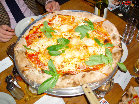 A thing of beauty, Lucali's plain pie's crispy crust is adorned with low-moisture mozzarella, bufala mozzarella, a sprinkling of Parmigiano-Reggiano and a five-hour simmered San Marzano tomato sauce. (Photo: Michael Anstendig)